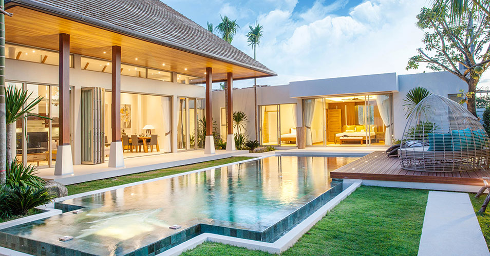 Backyard of an expensive home with an in-ground pool.