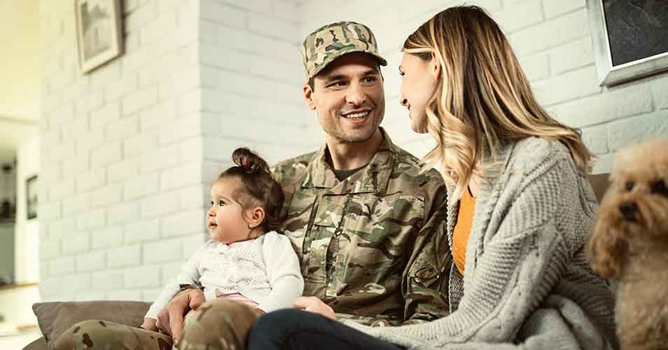 Military member smiling with his family.