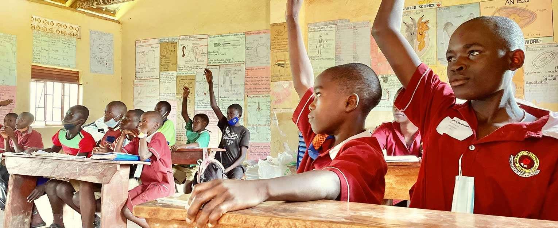 Ugandan students learning in a clasroom.