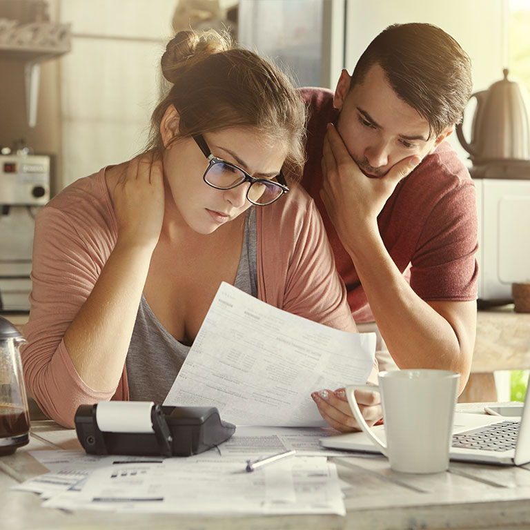 Couple going over their bills together.