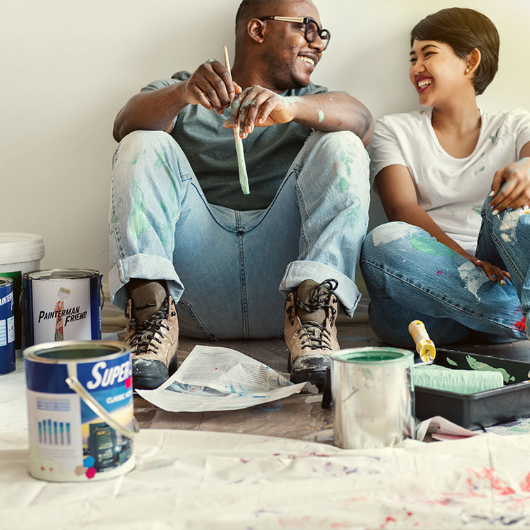 Couple taking a break from painting.