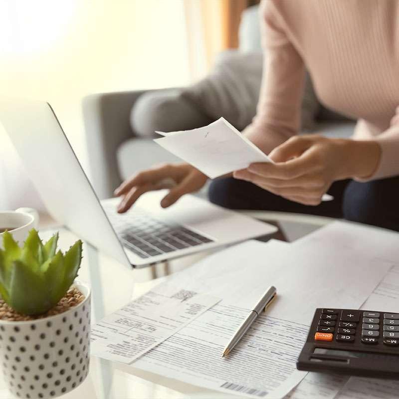 Woman paying bills on her laptop.