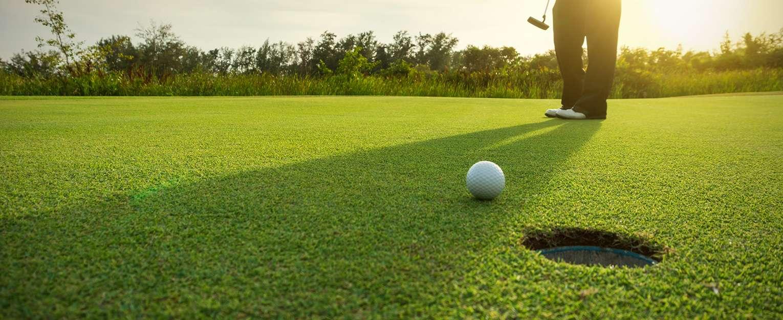 Man putting a golf ball.